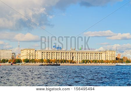 ST PETERSBURG RUSSIA - OCTOBER 3 2016. Petrovsky embankment - residential house for employees of People's Commissariat of the USSR Navy. On the roof - logos of VTB bank and Megafon company