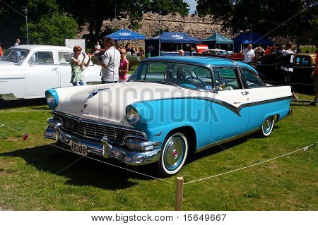 HAAPSALU, ESTONIA - JULY 18: American Beauty Car Show, showing white and blue 1956 Ford Fairlane 2D HT, front view on July 18, 2009 in Haapsalu, Estonia