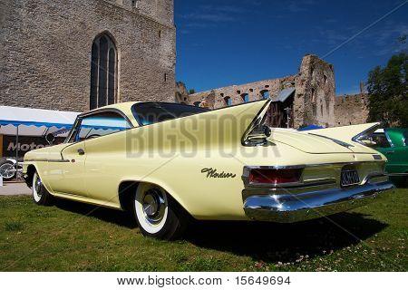 HAAPSALU, ESTONIA - JULY 18: American Beauty Car Show, showing beige 1961 Chrysler Windsor 2D HT, rear view on July 18, 2009 in Haapsalu, Estonia