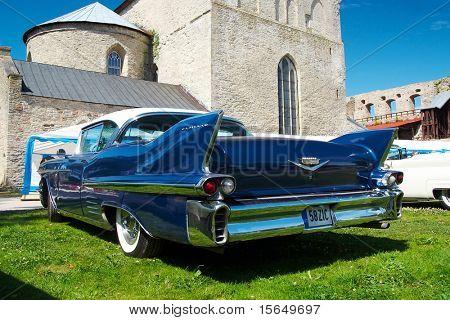 HAAPSALU, ESTONIA - JULY 18: American Beauty Car Show, showing blue 1958 Cadillac Coupe De Ville, rear view on July 18, 2009 in Haapsalu, Estonia