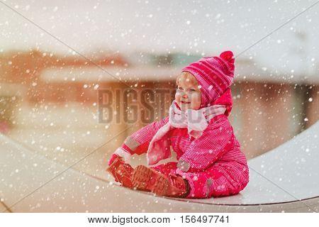 cute little girl enjoy first snow in the city, kids winter fun