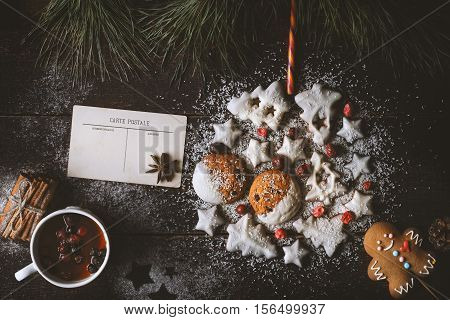 Christmas ball made by cookies on the wooden background with different accessorizes top view