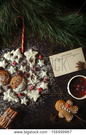Christmas ball made by cookies on the wooden background with different accessorizes