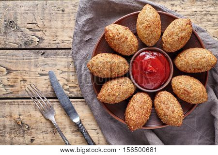 Kibbeh traditional middle eastern arabic lamb meat and bulgur kofta spicy meatball croquettes food on vintage wooden table background