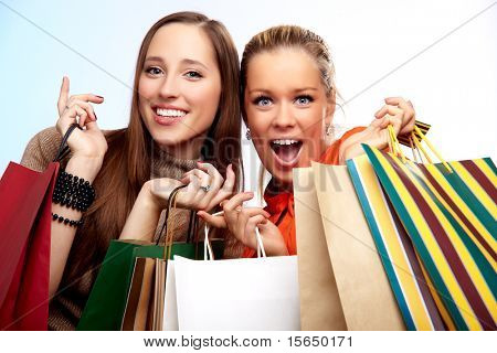Two happy teenage girls on a shopping