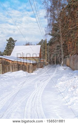 road in winter village covered with snow