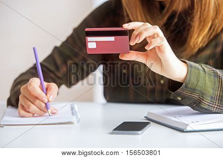 Woman With Credit Card Writing