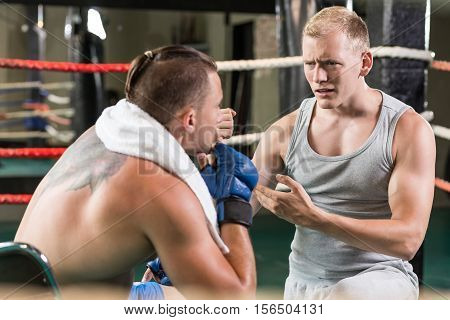 Boxer And Trainer On A Ring
