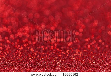 Bright red sparkling background from small sequins closeup. Brilliant and diamond backdrop.