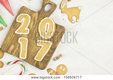 Ingredients For Ginger Cookies In The Form Of New 2017 Year With Honey And Cinnamon On A Wooden Back