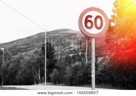 60 speed limit road sign with light leak background hd