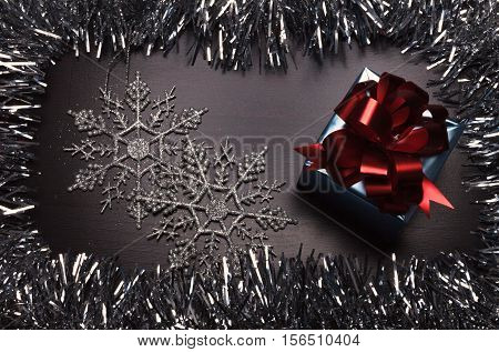 Gift Box With Snowflakes On Wooden Background