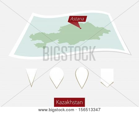 Curved Paper Map Of Kazakhstan With Capital Astana On Gray Background. Four Different Map Pin Set.