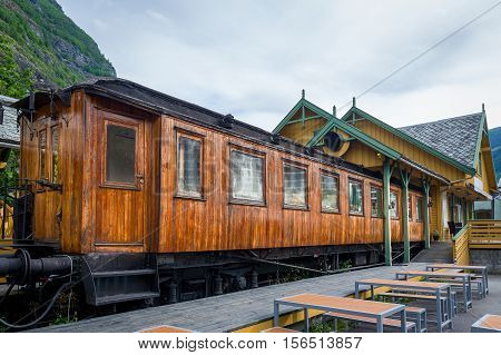 Retro wooden railway carriage at station of Flamsbana - famous old mountain railway in Flam, Norway.