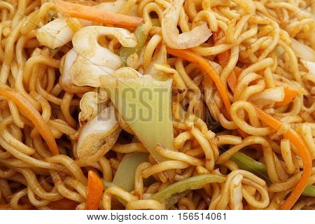 Chinese cuisine. Chinese food. Noodles with vegetables. Closeup.
