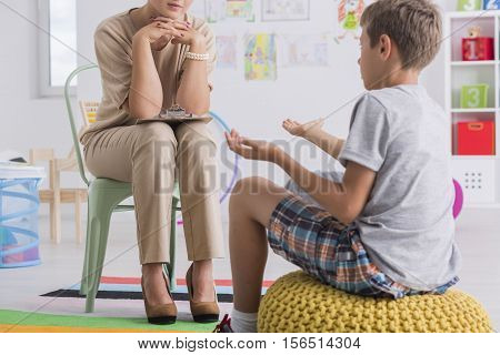 Child Sitting On A Pouf