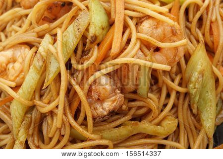 Chinese cuisine. Chinese food. Spaghetti with shrimps. Closeup.