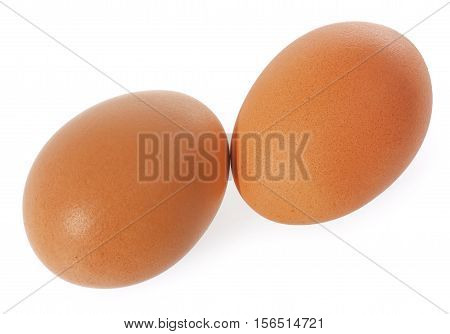 Two brown Eggs. Isolated on white background.