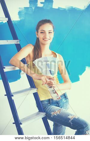 Young beautiful woman holding palette with collor samples