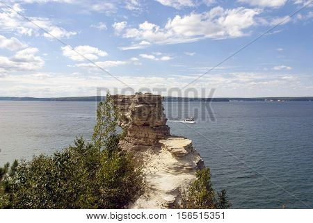 A boat carrying tourists passes Miners Castle at Pictured Rocks National Lakeshore, Lake Superior, Michigan, USA