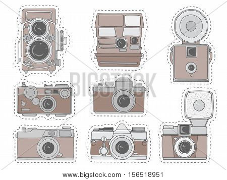 Colorful retro camera set. Hand drawn vintage photo cameras set with cute patterns. Vector illustration. Cute retro camera stickers in cartoon style