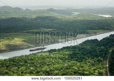Large cargo ship navigating through the Panama Canal