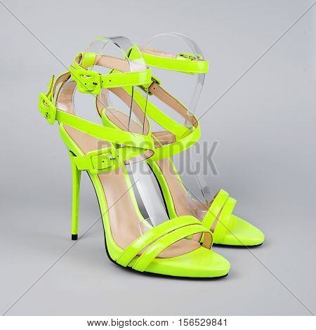 Yellow woman stiletto shoes isolated on white background