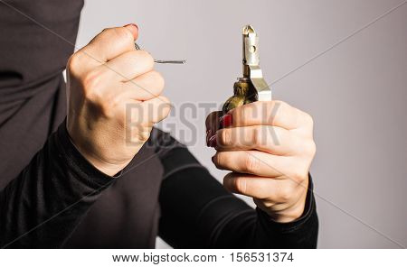 Woman's hand with pin of a grenade