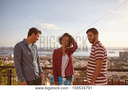 Three Friends And A Skateboard Laughing