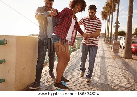 Friends Teaching Their Girlfriend To Skateboard