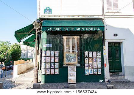 PARIS, FRANCE - circa april 2016; Small business in : Montmartre in Paris. Montmartre area is most popular destinations in Paris, has lots of cozy cafes, restaurants, bistros, night clubs and artistic studios.