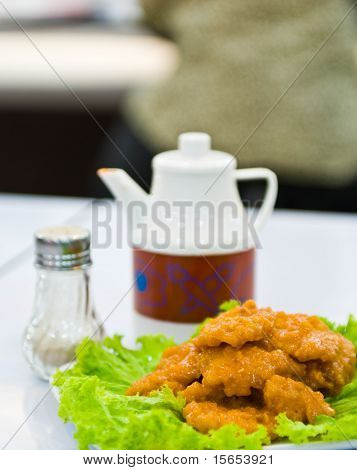 piece Fried fish with vegetable on dish poster