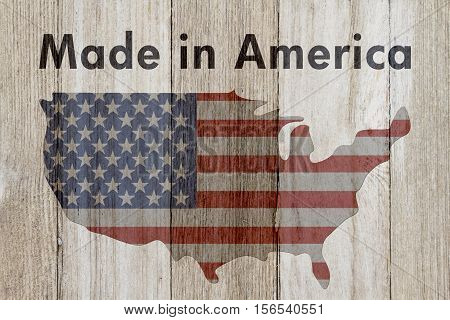 Made in America message USA patriotic old flag on a map and weathered wood background with text Made in America