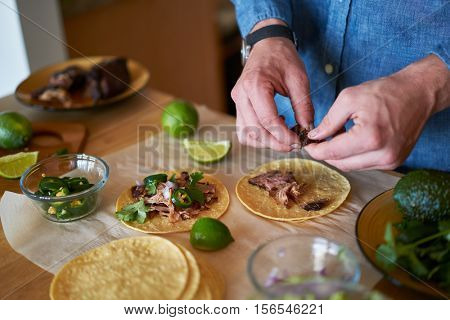 making tacos at home in kitchen
