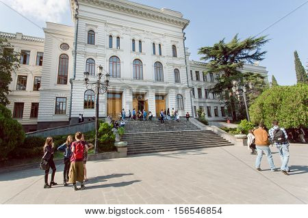 TBILISI, GEORGIA - OCT 10, 2016: Young people meeting and talking near the Tbilisi State University established 1918 on October 10, 2016. Tbilisi has a population of 1.5 million people