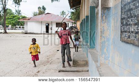 Zanzibar, Tanzania - July, 14, 2016: Editorial use -little african boys playing on a street in Zanzibar, Africa