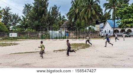 Zanzibar, Tanzania - July, 14, 2016: Editorial use - little african boys playing on a street in Zanzibar, Africa