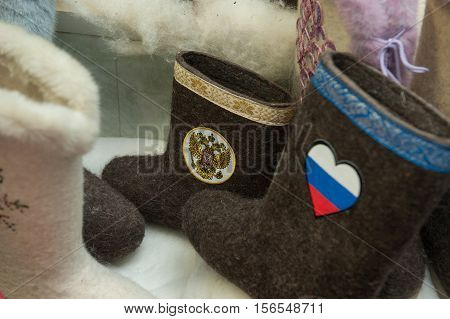 Gatchina Leningrad Region Russia - December 15 2014: The production line for the manufacture of Russian felt boots with the national Russian state symbols