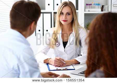 Friendly Female Family Doctor Listen Carefully Young Couple