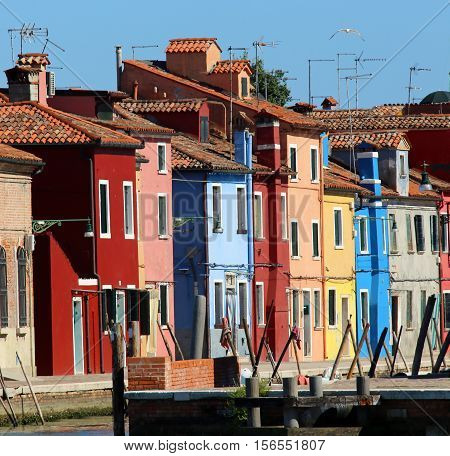 Colored Houses On Canal In Burano Island Near Venice In Italy