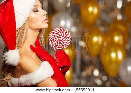 Portrait of beautiful sexy girl wearing santa claus clothes .