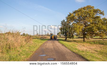 Tractor on a country path on farmland in Essex