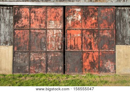 Old rusty red barn doors on the farm