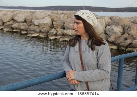 A young lady looks over Grand Traverse Bay in Traverse City, Michigan