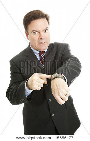 Businessman impatiently pointing to his watch.  Isolated on white.