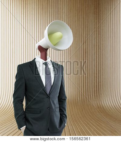 Loud speaker headed businessman on wooden background. Communication voice and power concept
