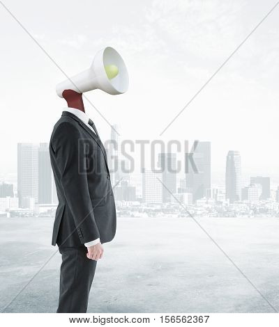 Loud speaker headed businessman on city background. Side view. Communication voice and power concept