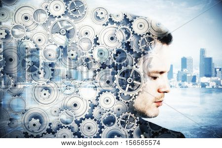 Side portrait of young man with cogwheels on city background. Brainstorming concept. Double exposure