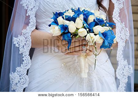 Beautiful wedding bouquet in bride's hand. Soft focus