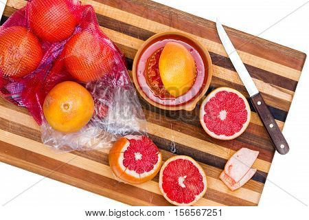 Whole And Sliced Ruby Red Grapefruit With Knife